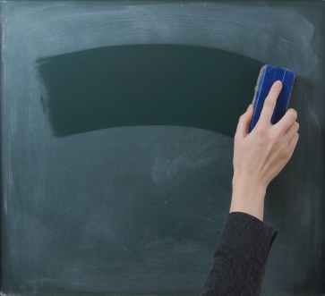 Teacher cleaning the chalkboard, suits horizontal composition
